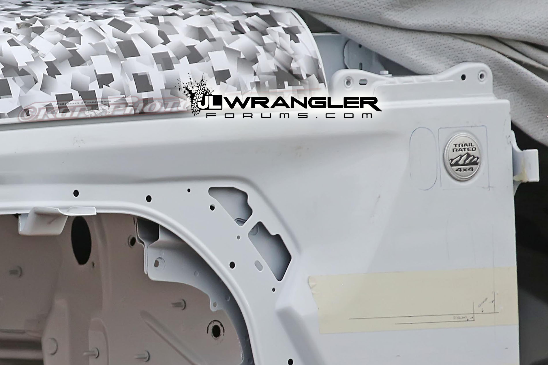 Wrangler Unlimited Rubicon >> JL Wrangler body in white shell shows fender lights + vents, hood latches + design, roll cage ...